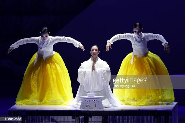 Women perform onstage during the PyeongChang 2018 Olympic and Paralympic Winter Games 1st Anniversary Festival In Gangneung on February 09 2019 in...