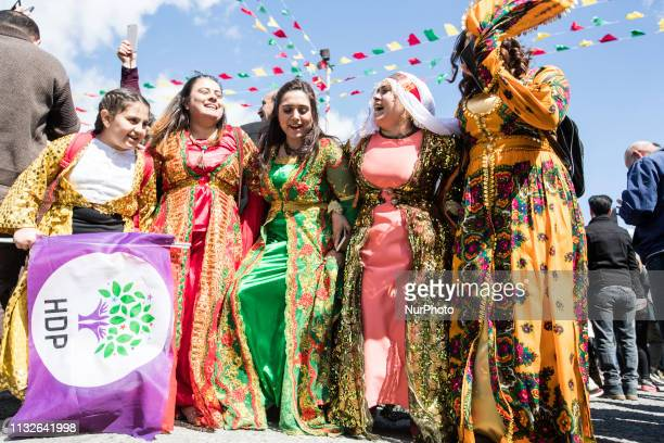 Women perform traditional dance during the Newroz celebrations wearing traditional clothes participate in Nowroz in Istanbul Turkey on March 24 2019