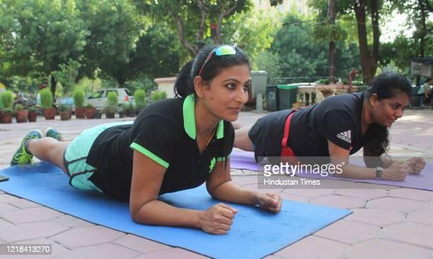 Women perform yoga near Galleria market DLF Phase 4, on June 7, 2020 in Gurugram, India.