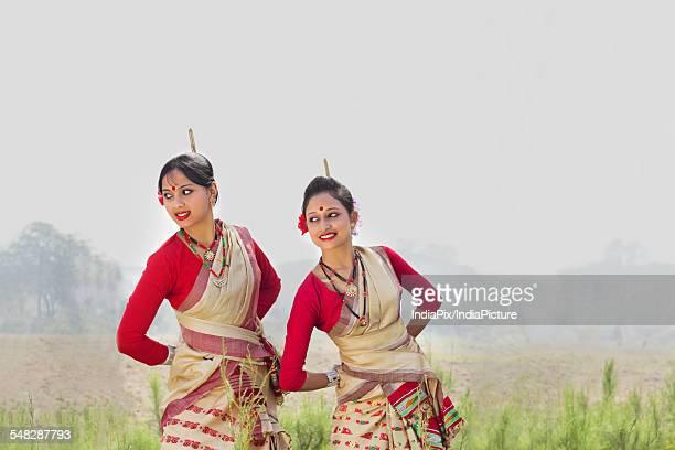 Women performing Bihu dance