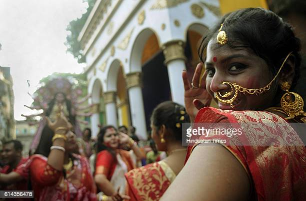 Women performing dance during the immersion procession of Goddess Durga idol on October 13 2016 in Kolkata India Dhunachi is an Indian incense burner...