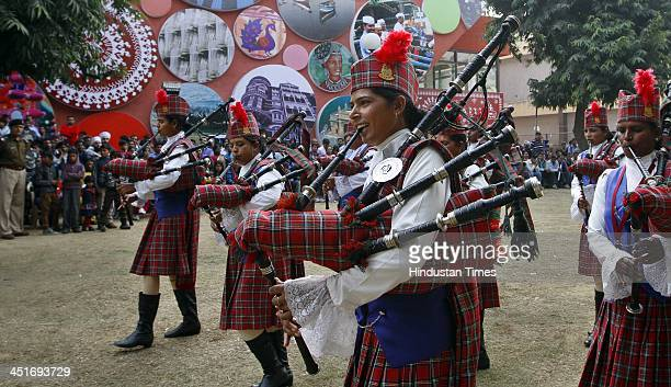 CRPF women personnel perform bagpipes and drums during the demonstration at India International Trade Fair on November 24 2013 in New Delhi India The...