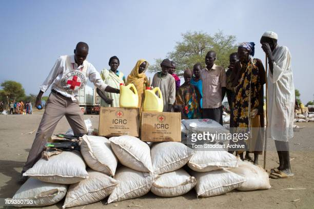 Women photographed during an International Committee of the Red Cross distribution of seeds agricultural tools and food staples to households in...