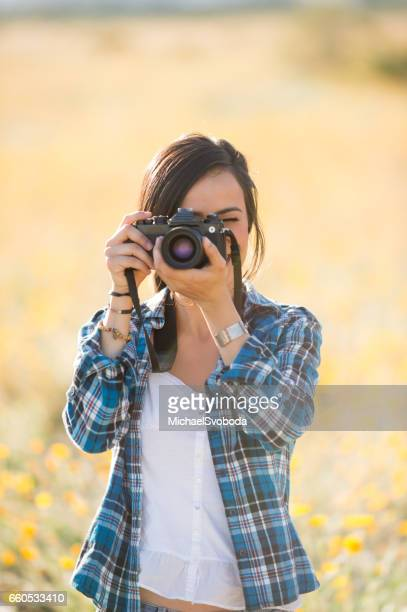 Women Photographer In The Wild Flowers