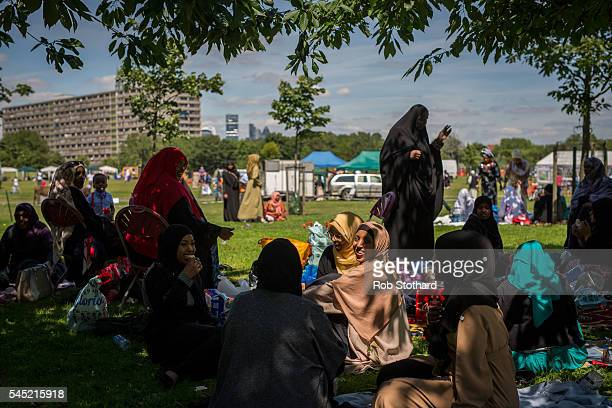 Women picnic as they celebrate the festival of Eid at Southwark Eid Festival in Burgess Park on July 6 2016 in London England Thousands gathered at...