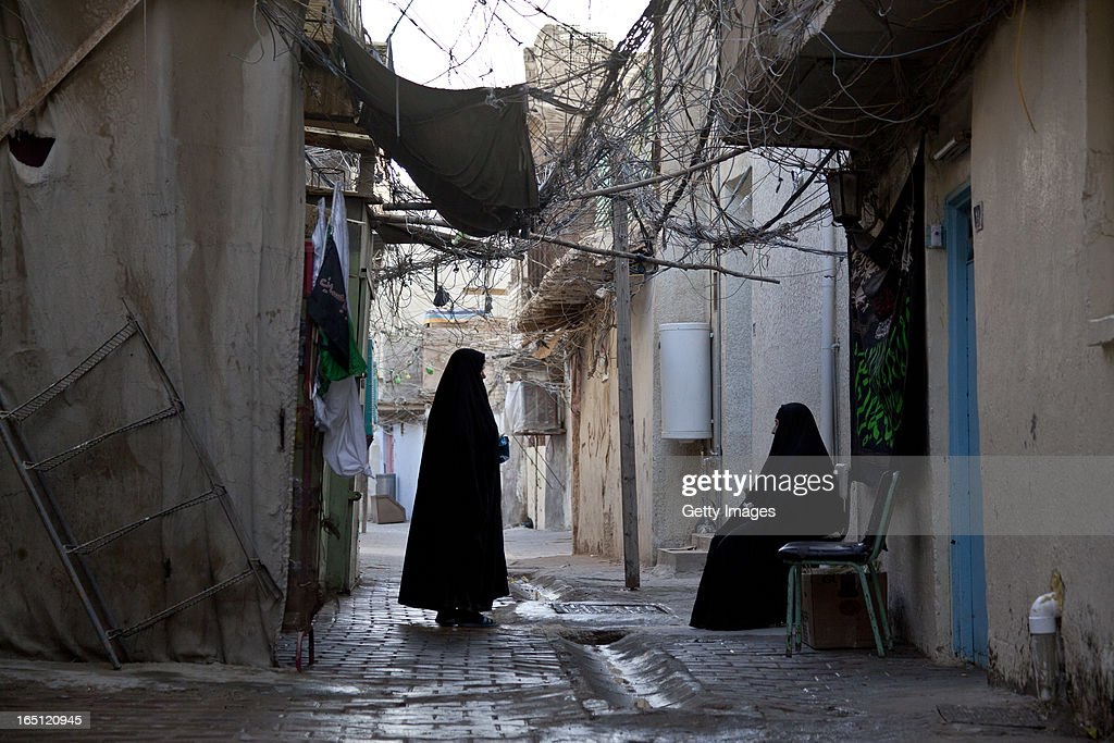 Women pictured in the area of al Shawaka on March 29, 2013 in Baghdad, Iraq. Ten years after the regime of Saddam Hussein was toppled from power, Baghdad continues to show the scars of the war. In vast areas, infrastructure is fractured and basic services are lacking, however, some areas of the capital are showing promising signs of recovery.