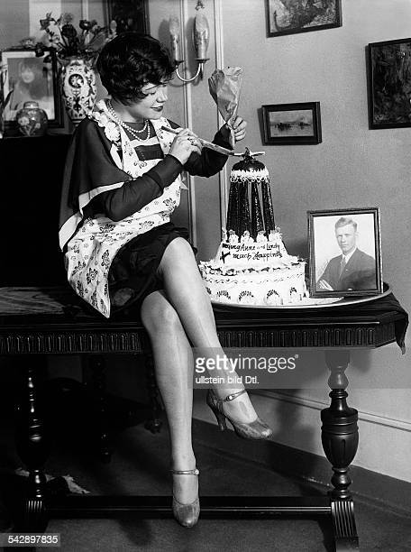 Women pictures A fan of the pilot Charles Lindbergh decorating a cake on the occasion of the marriage of Anne and Charles Lindbergh 1929 Vintage...