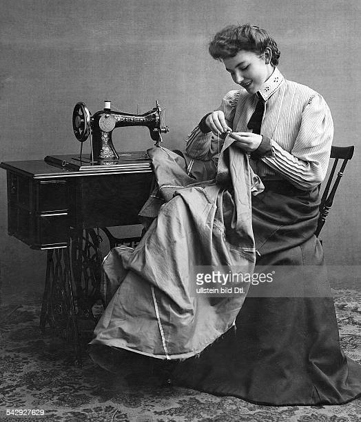 Women pictures Woman sewing on a Singer sewing machine undated probably 1900 Photographer Zander Labisch Vintage property of ullstein bild