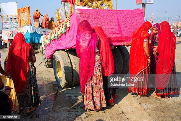 Women pilgrims at Maha Kumbh mela. Kumbh Mela is a site of mass pilgrimage in which Hindus gather at a sacred river for a holy dip. It is held once...