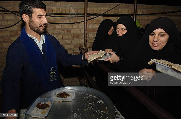 Women pilgrims receive food at the Jamkaran Mosque December 6 2005 in Jamkaran Iran Some Iranian Shiites believe and are waiting for the return of...