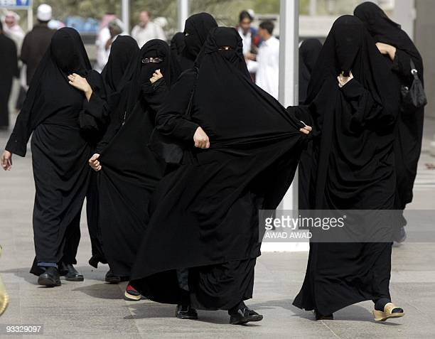 Women pilgrims wearing burkas make their way to the Prophet Mohammed's Mosque in Medina 24 January 2004 More than 11 million Muslims from around the...