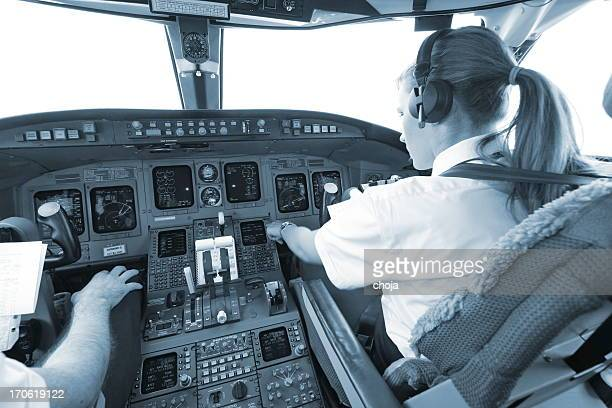 Women pilot above the clouds...cockpit of commercial jet