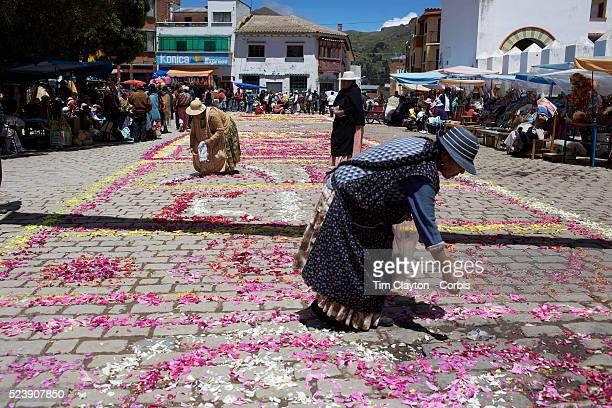 Women place flower petals on the ground, during the festival of the Virgen de la Candelari. One of Bolivia's most famous festivals, the festival of...