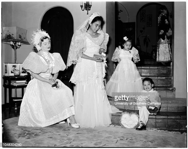 YWCA women planning fashion show 28 January 1954 Mrs George TatarMrs Teofilo AlemaniaRita Navalta 4Roderick Alemania 3 1/2 Caption slip reads...