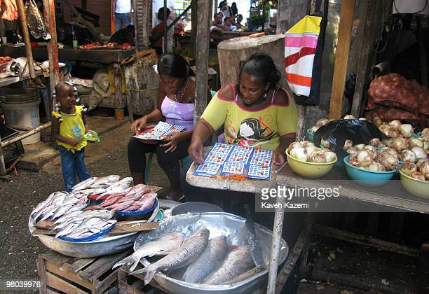 BUENAVENTURA COLOMBIA DECEMBER 29 2009 Women play a game of bingo while sat in the market place in downtown Buenaventura Buenaventura is a port city...
