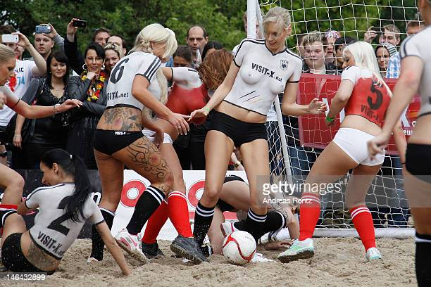 Women play in German and Danish team strip body paint during the 'Sexysoccer2012' match at StrandgutBerlin on June 16 2012 in Berlin Germany The...