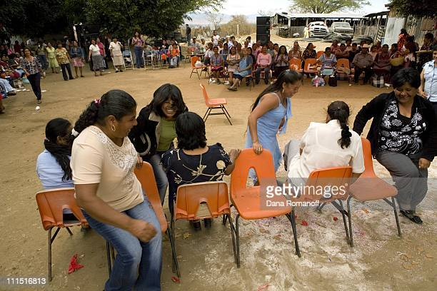 Women play musical chairs during a meeting of the Organizacion Pricessa Dona Aji on February 14 2008 on a ranch in Zimatlan The group organzed 15...