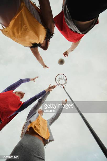 women playing a game of netball - try scoring stock pictures, royalty-free photos & images