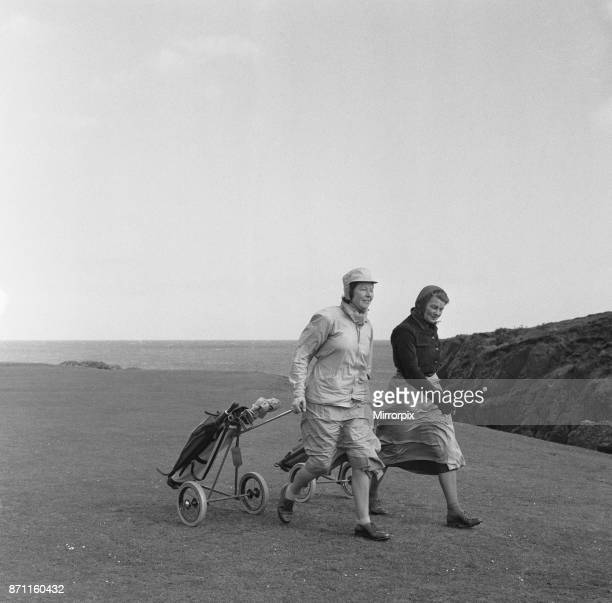Women playing a round of golf on a very windy Fort Island Golf links Hotel on the Isle of Man course 7th May 1954