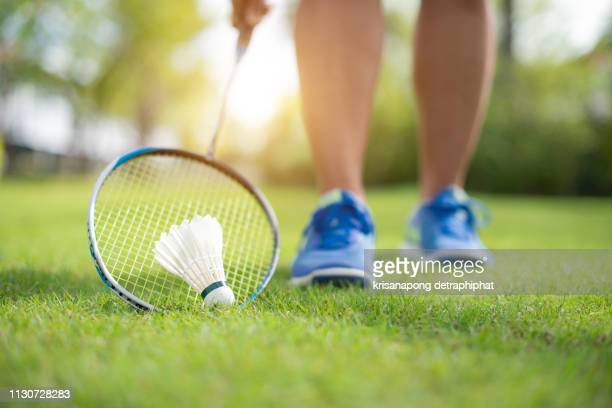 women playing badminton,badminton - shuttlecock stock pictures, royalty-free photos & images