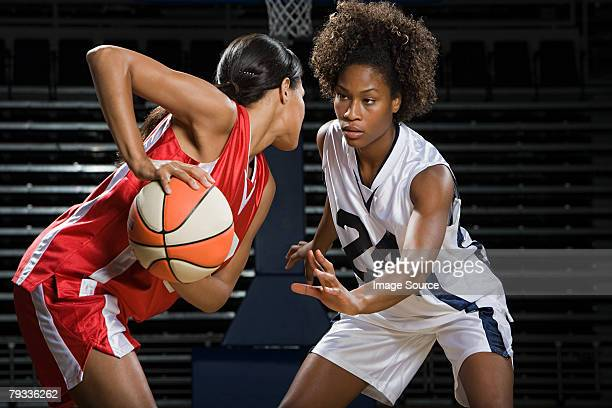 women playing basketball - black shorts stock pictures, royalty-free photos & images