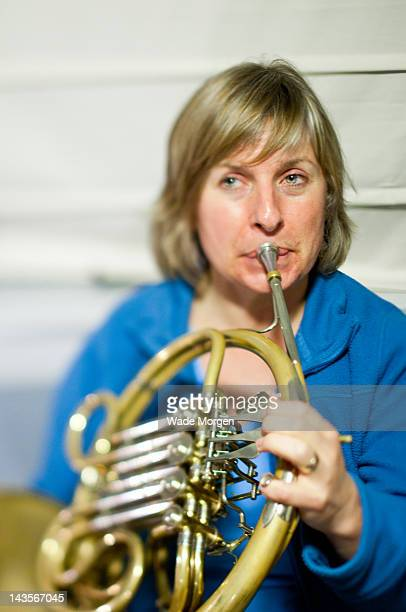 women playing french horn - morgen stock pictures, royalty-free photos & images