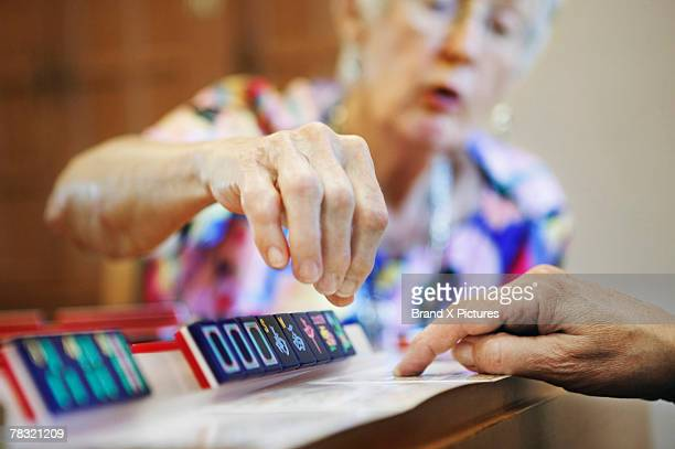 women playing game - mahjong stock photos and pictures