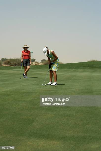 women playing golf - schlebusch stock pictures, royalty-free photos & images