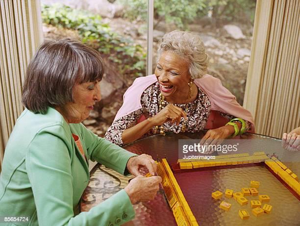 women playing mahjong - mahjong stock photos and pictures