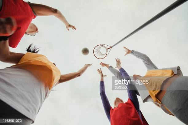 women playing netball - try scoring stock pictures, royalty-free photos & images