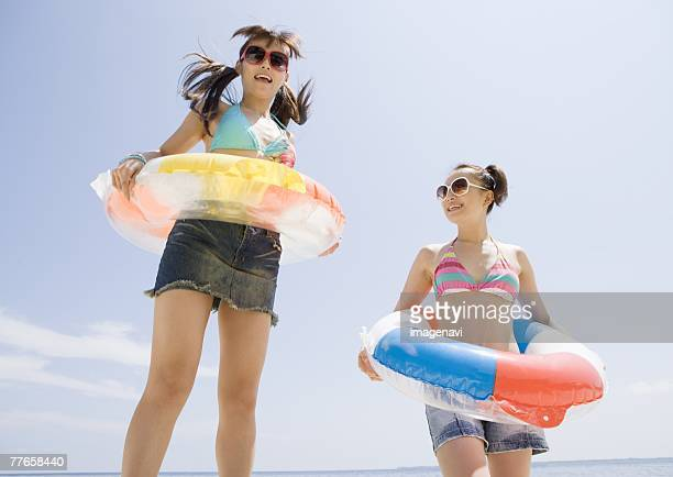 women playing on the beach - japanese short skirts stock photos and pictures