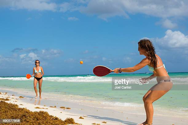 Women playing paddle ball in Playa del Carmen