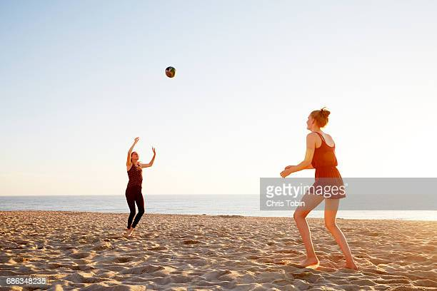 Women playing volleyball at the beach