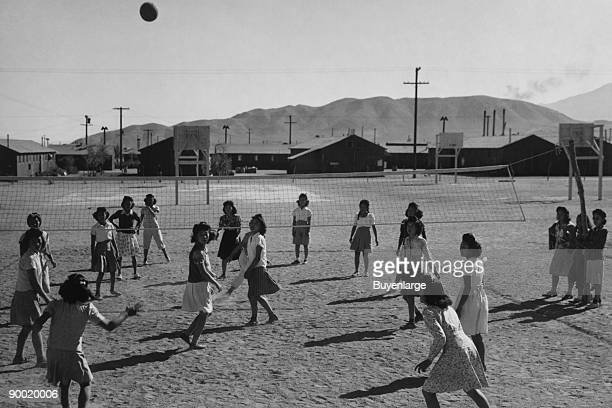 women playing volleyball onestory buildings and mountains in the background Ansel Easton Adams was an American photographer best known for his...