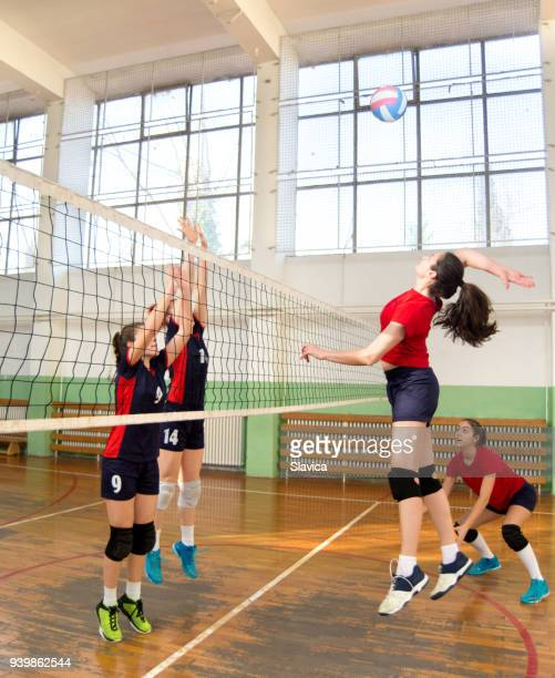 women playing volleyball - high school volleyball stock photos and pictures
