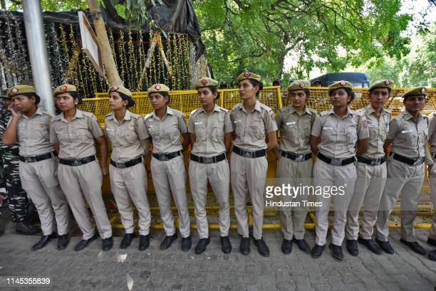 Women police constables stand guard outside Election Commission of India as 21 opposition party leaders arrive to meet the Election Commission at...