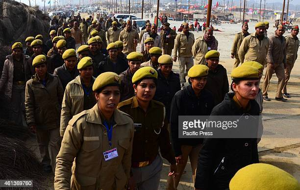 Women Police patrol for security managment at Magh mela area ahead of Makar sankranti festival It is one of the largest Hindu gatherings in which...