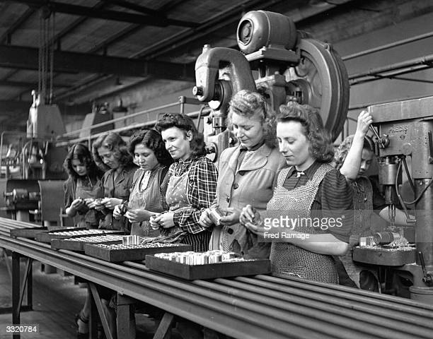 Women polishing bearing liners at the Ford factory at Niehl during the German motor car industry's rebirth following World War II.