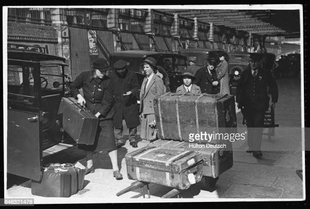 Women porters work at Paddington Station 1942