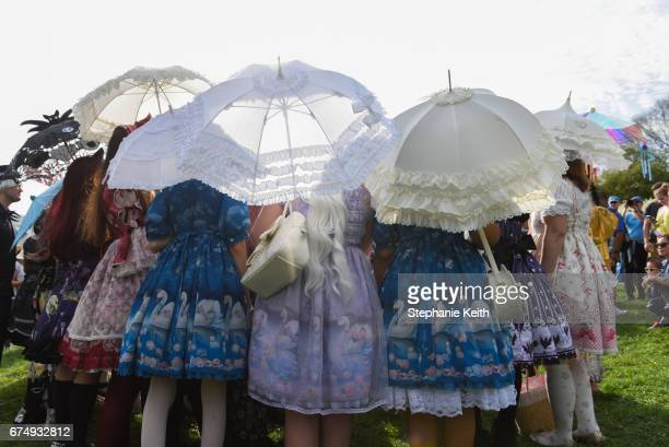 Women pose for a photo after participating in the BBG Parasol Society Fashion Show which celebrates Lolita style fashion at the Brooklyn Botanic...