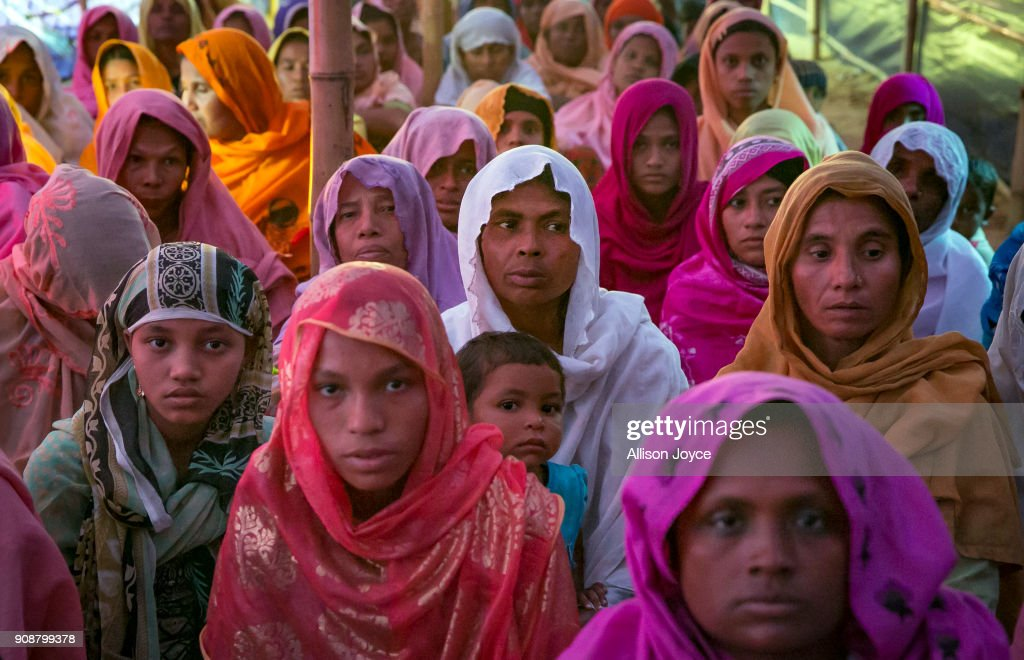 COX'S BAZAR, BANGLADESH - JANUARY 19: Women pose for a photo January 19, 2018 in Cox's Bazar, Bangladesh. In the refugee settlement of Balukhali, over 116 widows and orphans have found shelter within a dense settlement of 50 red tents where no men or boys over the age of 10 years old are allowed. More than 655,000 Muslim Rohingya have crossed the border into Bangladesh since August last year, when they fled Rakhine state after the Myanmar military launched a brutal crackdown which was described by the United Nations as 'ethnic cleansing'. Women and girls reportedly make about 51 percent of the distressed and traumatized Rohingya population in the refugee camps and face a high risk of being victims of human trafficking and sexual abuse, while adolescent girls aged between 13 and 20 risk getting involved in forced marriages. Many of the Rohingya women travelled alone after their husbands had been killed or taken away during the attacks on Rohingya villages as many continue to fear returning home due to the lack of security guarantees.