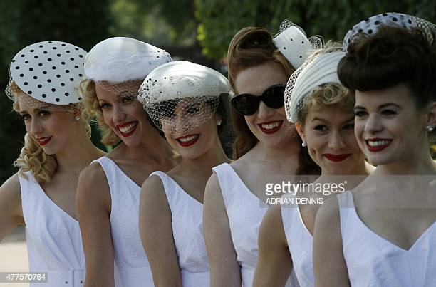 Women pose for a photograph during Ladies' day at Royal Ascot, in Berkshire, west of London, on June 18, 2015. The five-day meeting is one of the...