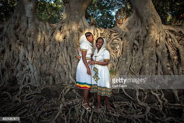 Women pose for a photograph in traditional Ethiopian dress during the annual Timkat epiphany celebration on January 18 2017 in Gondar Ethiopia Timkat...