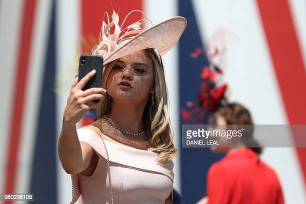 Women pose for a selfie on Ladies Day at the Royal Ascot horse racing meet in Ascot west of London on June 21 2018 The fiveday meeting is one of the...