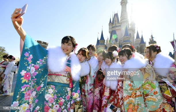 Women pose for photos at Tokyo Disneyland during a ceremony celebrating their coming of age in Urayasu near Tokyo on Jan 14 2019 ==Kyodo