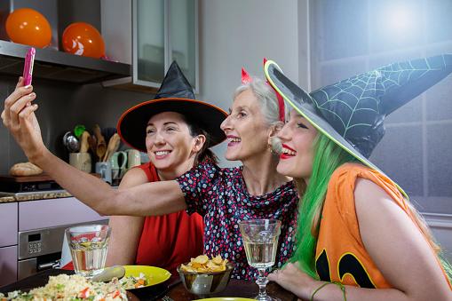 Women Pose for Selfie, dressed up for Halloween. - gettyimageskorea