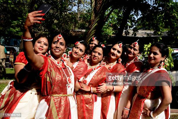 Women pose for selfie during an event organised for Women on International Womens Day at Vishnudas Bhave Auditorium at Vashi on March 8 2019 in Navi...