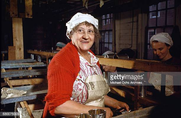 A women poses as she work in the cannery in Lubec Maine