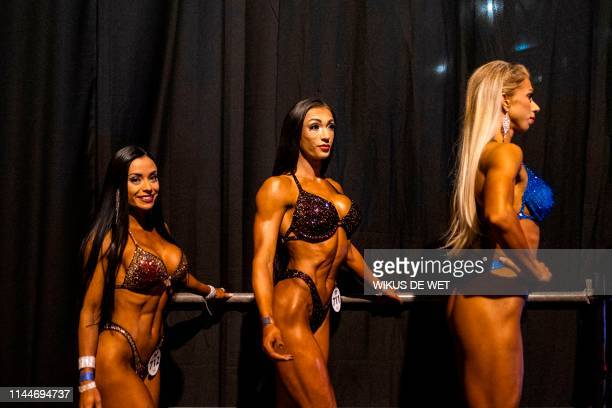 Women poses for a photograph ahead of the Bikini Fitness Competition at the Arnold Classic Africa, a multi-sport festival held at the Sandton...