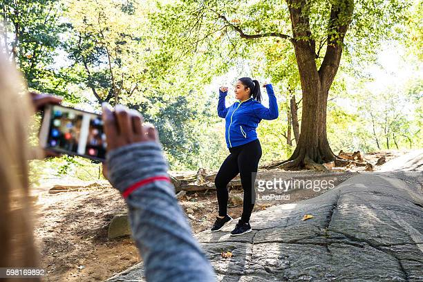 women posing post workout in central park new york - fat woman funny stock photos and pictures
